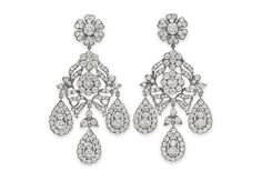The Mike Todd diamond ear pendants, 1957<p>Fake or fine, no one delighted more in receiving gifts of jewelry than Elizabeth Taylor. She was in Paris with husband Mike Todd when she saw these earrings, and though they were paste, she desperately wanted them. Todd obliged. A few months later he surprised Elizabeth by having them copied—all in diamonds. How did she thank him? Well, it made them late for a party . . .</p><p>Courtesy of Christie's.</p>