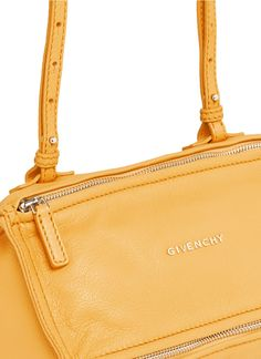 Breaking from its dominant dark romanticism, Givenchy decks its coveted Pandora bag in a delectable yellow. Compact in size yet huge in status, this iconic crossbody is a must-have for fashionistas.