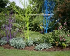 Paint dead trees a bright color for instant garden art! by geraldine