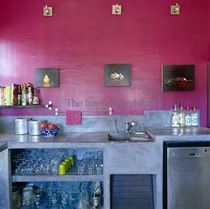 In this bright contemporary kitchen the open shelving is constructed from concrete and the walls are painted a vivid fuschia pink Room Colors, Wall Colors, Colours, Bedroom Carpet, Open Shelving, Soft Furnishings, Kitchen Storage, Decoration, Sweet Home