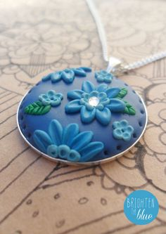 Lovely blue floral necklace made from polymer clay available on Etsy!  https://www.etsy.com/uk/listing/162994684/blue-floral-polymer-clay-pendant-with