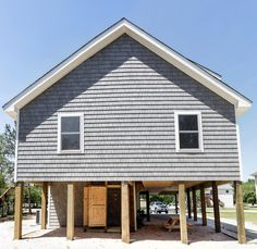Rear of Custom built beach home in Kill Devil Hills, NC. Beach Homes, Devil, Coastal, Shed, Outdoor Structures, Cabin, House Styles, Building, Home Decor
