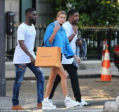 Not a bad day! The model was seen carrying a large, Louis Vuitton shopping…
