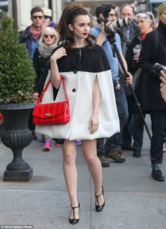 Standing out: The star posed up a storm in her chic ensemble as she modelled the retro look outside designer store Bergdorf Goodman