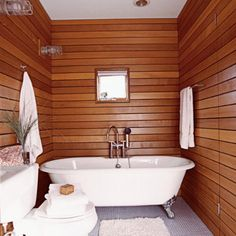 """The rosy hue of cedar walls instantly warms up a room. Used in a small space such as this bath, the effect is cozy and nautical?as though you've just stepped below deck.""  Photo: Jeff McNamara, Writer: Sophie C. Good."