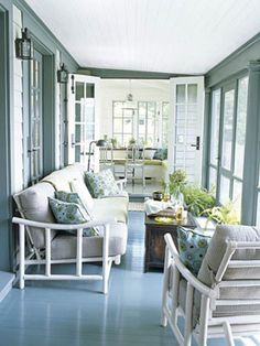Paint the Floor:   Architect Gil Schafer screened in this Connecticut lake cottage's open porch. Color expert Eve Ashcraft chose Narragansett Green for the porch floor from Benjamin Moore. The gleaming shade makes the floor almost look like water. The white-lacquered '50s rattan sofa and armchair are from the homeowner's grandmother.