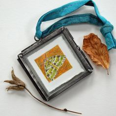 1 inch high pencil drawing of a tiny Green Carpet Moth, drawn to actual size with a wing span of Supplied in zinc 'vintage style' frame. Drawing is signed on the back in pencil by the artist. Green Carpet, Colored Pencils, Pencil Drawings, Moth, The Originals, Frame, Handmade, Vintage, Green Mat