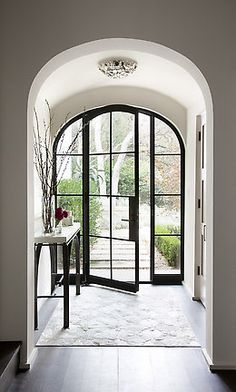 Unique shape for entry door.  Lots of light let in ♥