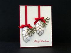 Love the pine cones. stampin up bird wing perhaps? Or maybe Martha's rose leaf punch?