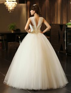 sleeveless sweetheart tulle wedding dress with beading  Ball Gown,Floor Length,Natural,Sweetheart,Sleeveless,Beading,Pleats,Zipper,Tulle,Church,Garden/Outdoor,Hall,Spring,Summer,Fall,