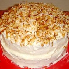 """""""A delicious coconut cake made from a cake mix with coconut cream cheese frosting and garnished with toasted coconut."""""""