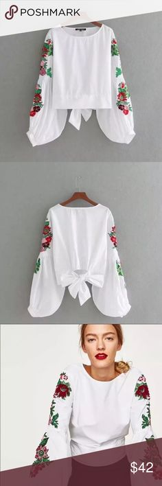 NWT embroidered blouse Gorgeous white blouse with bell sleeves and embroidery, tie back! This top is simply beautiful and I am so sad to sell! It is a reposh item only because it does not fit me! 😢 Tops Blouses