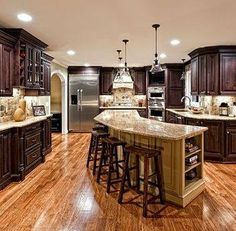 Mahogany cabinets. Note to self..... Bifolds, exterior doors painted light trim color. French doors and chair rail java gel stain. Backsplash beadboard still not sure. Peninsula wall color with corbels.