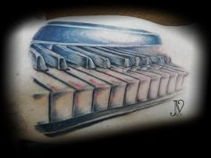 piano keys! this was taken right after it was finished! this tattoo was done in grey tones, based on a picture my client had taken! tattoo by jenny vidovic (seattle)
