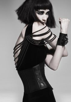 Tough: heavy bangs, blunt cut, strappy dress with leather corset. So good.