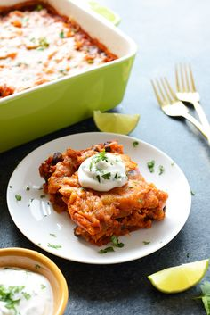 In just 60 minutes you can make this healthy chicken enchilada casserole that's packed with lean chicken, beans, tons of veggies, and brown rice. Throw everything into a casserole dish uncooked (that's right...UNCOOKED) and you've got yourself dinner for the entire family.