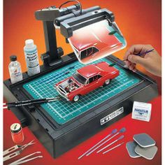 Hobby Work Station for Modelers and Craft Work.Tamiya's Work Stand turns any table top into a complete model builder's workstation . The 12 x 18 inch work surface incorporates a well for decal water and a holder for paint b. Hobbies For Women, Hobbies To Try, Hobbies That Make Money, Hobbies And Crafts, Arts And Crafts, Model Hobbies, Hobby Desk, Hobby Tools, Tools Tools