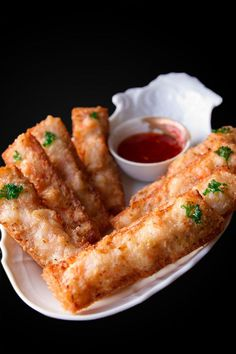 Shrimp Toast ~ Originally a Chinese appetizer called Hatosi, this is a simplified version that makes for a great party canapé. Each toast has a layer of crisp sandwich bread on one side, and ginger and scallion flavored minced shrimp on the other. Dipped in sweet Thai chili sauce these shrimp toasts are dangerously addictive!
