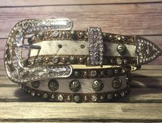 Work, play, lookin' cowgirl good all the same! This women's hair-one leather belt from Angel Ranch features floral tooling, silver tone studs, clear crystals and a silver tone buckle set with crystals