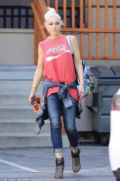 Gwen Stefani had tied an ornately embroidered denim jacket at her waist, complementing her...