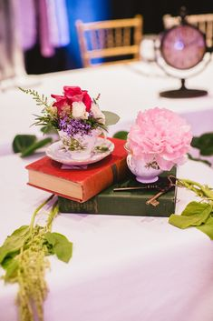 Rachel and Raymon based their wedding on Rachel's favourite childhood book and film - Alice in Wonderland! They had oodles of personalised and special details including the mismatched chairs, the vintage door seating chart, having clocks as table numbers and their chequered dance floor.