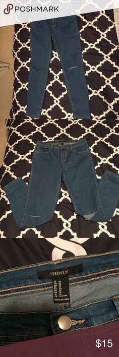 Forever 21 blue jeans with slit at knee size 30 Only worn once, these jeans can be dressed up or down with a more relaxed fit. Size 30. 71% cotton 27% polyester Forever 21 Jeans Skinny