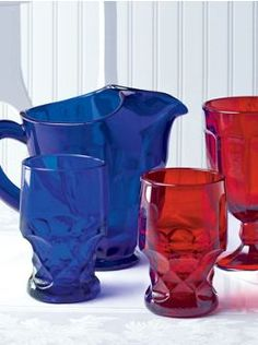 Mosser glassware in three deeply vibrant colors—cobalt blue, emerald green, and ruby red
