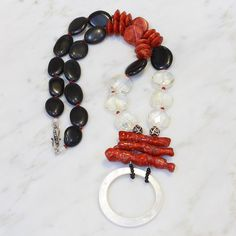 Jan's Description This one-of-a-kind statement necklace is sure to turn heads! I used branch coral and a mother of pearl ring to create a unique and striking centerpiece pendant. I paired that with sm