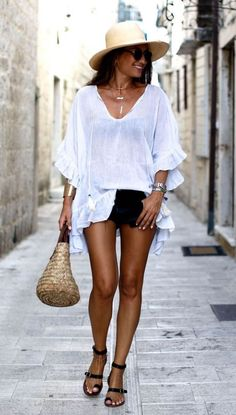 trendy vacation outfit idea : hat + bag + white tunic + shorts + sandals