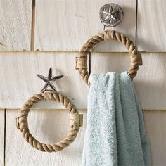 2 styles: starfish and sand dollar. Towel ring features cast aluminum icon and real rope ring.