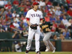 CrowdCam Hot Shot: Texas Rangers starting pitcher Derek Holland reacts to giving up a three run home run in the first inning of the game against the Oakland Athletics at Rangers Ballpark in Arlington. Photo by Tim Heitman