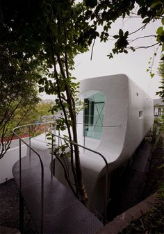 japanese architect Norisada Maeda's celluloid jam house in yokohama, japan. the house was constructed with fibre reinforced plastic (FRP). the form of the house was based around an elastic band, where cuts were made for various openings.
