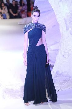 Gaurav Gupta At India Couture Week 2016 Saree gown navy blue with caped shrug Saree Draping Styles, Saree Styles, Dress Styles, Indian Dresses, Indian Outfits, Pakistani Dresses, Anarkali, Lehenga, Saree Gown