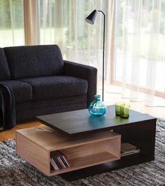 Coffee table with small book shelf.