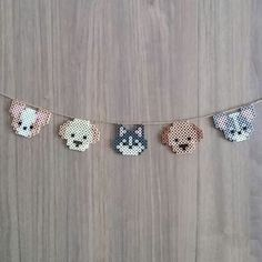 Perler dogs on a string Easy Perler Bead Patterns, Melty Bead Patterns, Perler Bead Templates, Diy Perler Beads, Perler Bead Art, Pearler Beads, Hama Beads Kawaii, Loom Patterns, Quilt Patterns