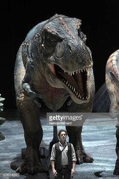 An animatronic Tyrannosaurus rex dinosaur is on display along with Jared Van Heel who plays the part of the Paleontologist before the opening day of. Tyrannosaurus Rex, Opening Day, Prehistory, Plays, Lion Sculpture, Elephant, Display, Statue, Heels