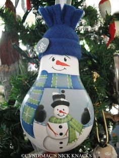 Snowman and Little Snowman Buddy Lightbulb Ornament, handpainted - This ornament is painted on a burnt out lightbulb with acrylic paints. This would be a great addition for any snowman collector!
