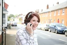 Bride calling father on the street in Clare, suffolk