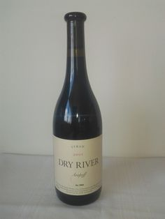 Dry River Arapoff Syrah 2001, Martinborough, New Zealand.    Intensely coloured deep red with hints of purple. A huge aroma of plum, spice and pepper and raspberry flavours in the background. Ripe tannins, excellent length, still young leave for another 5 years minimum.  For more information on cellaring wines go to www.click-on-wine.com