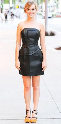 MAY 4, 2014  Ahna O'Reilly revealed a sexy side at a Fendi event in a black leather strapless dress and orange crystal-shaped sandals, both by Fendi