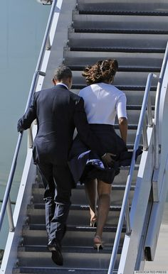 """If President Obama doesn't look very """"presidential"""" in this photo -- au contraire!  He's saving his wife from a """"Marilyn Monroe"""" moment!"""