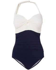 This classic colour block swimsuit is styled with a twist front detail and detachable halter strap.