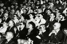 Theater audience wearing 3-d glasses. Looks photoshopped! : )