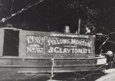 """the cabin and stern of the """"Fellows, Morton & Clayton, Ltd"""" motor narrowboat """"Ling No (""""Registered at Birmingham, No Jim Moore is at the tiller of the boat, there is a decorated item on top of the cabin and the doors to the engine room are open. Canal Barge, Canal Boat, Old Boats, Narrowboat, Birmingham, Engine, Cabin, Doors, History"""