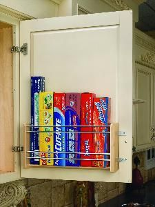 Wall 18 Door Mount Foil Rack, 10-1/8 Wide. Store your foil, plastic wrap and plastic storage bags eye level. The Door Mount Foil Rack will free up valuable drawer space. Simply swing open your cabinet to view your wraps instead of digging through a cluttered drawer! Made from maple with chrome rails it is ideal for any decor and the patented adjustable mounting brackets ensure easy installation on various door styles.