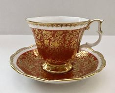 Vintage china tea cup and saucer made by Royal Albert in England. Buckingham Series in Orange. It is in good condition, no chips, cracks or crazing. Please Note: The items I sell are not new, they are vintage or antiques, it goes without saying that there maybe some
