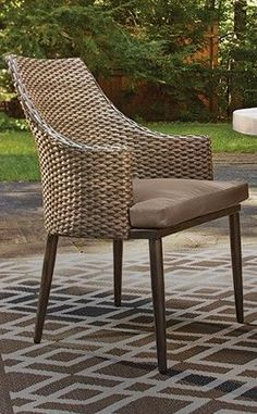 Add a unique and stylish touch to your outdoor dining set with the CANVAS Seabrooke Wicker Patio Dining Chair