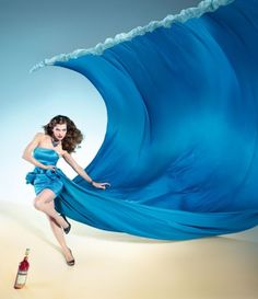 """Mila Jovovich and Campari """"It's the end of the world, baby!"""" 2012 calendar."""
