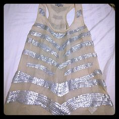 Chiffon tanktop with silver sequin design- M Cream chiffon tank top with silver sparkle sequin design pattern. Like new! Size medium. sylk Tops Tank Tops