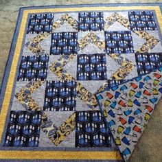 My youngest son is turning 35 on Sept. 1st and he has been a Doctor Who fan forever.  When I saw the Doctor Who fabric I knew I just had to make a quilt for his birthday.